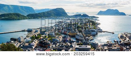 Picturesque panorama of Alesund port town on western coast of Norway. Place where the ocean meet the mountains