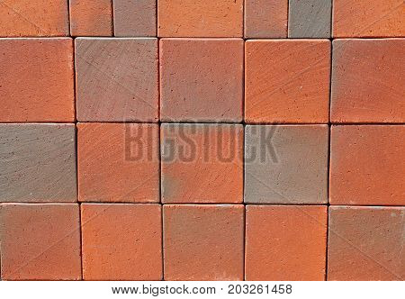 Red Luxury Vintage Ceramic Clinker Pavers. Floor pavers in a path detail of a pavement to walk textured background