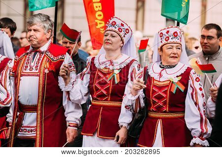 Gomel, Belarus - May 9, 2015: People in national Belarusian folk costume participating in the parade dedicated to the Victory Day - the 70th anniversary of the Victory in the Great Patriotic War