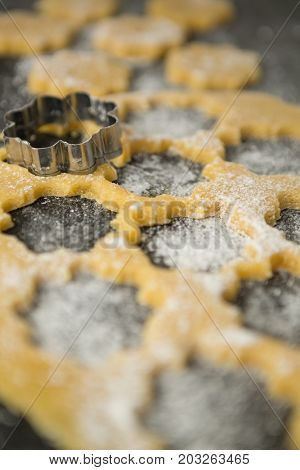 Flower shape mould on dough at table