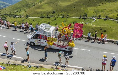 Col de PeyresourdeFrance- July 23 2014: Cofidis vehicle passing in the Publicity Caravn on the road to Col de Peyresourde in Pyrenees Mountains during the stage 17 of Le Tour de France 2014.