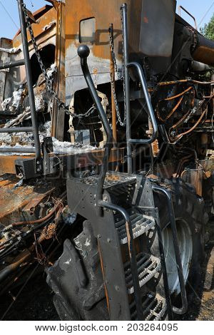 Closeup of a burnt out combine harvester