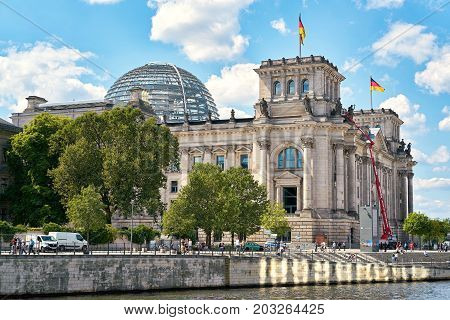BERLIN, GERMANY - AUGUST 07, 2017: The Reichstag in Berlin on the banks of the river Spree. The Reichstag is one of the most important sights of the city