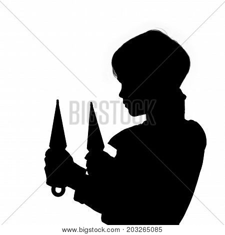 Black silhouette of little ninja holding throwing knives