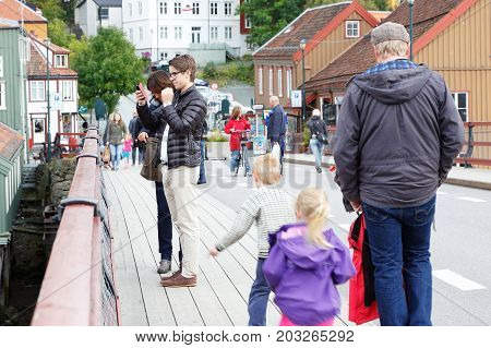 Trondheim Norway - September 26 2015: People on the Old town bridge (Gamle Bybro). The bridge has a length of 82 meters and was constructed in 1861.