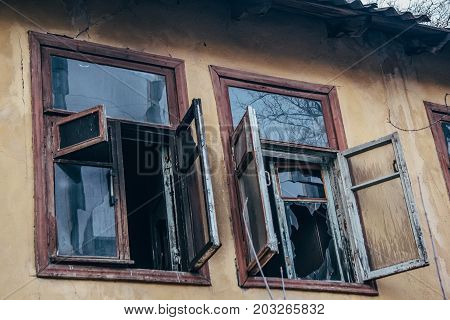 Opened broken windows of burned by fire house