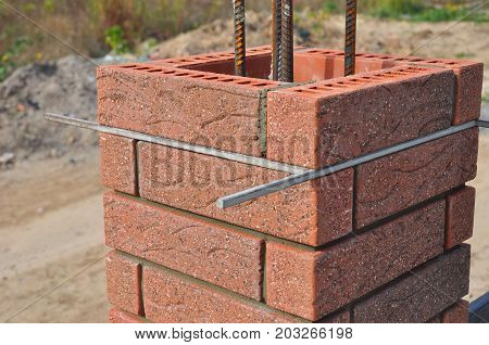 Lay bricks and blocks correctly.Closeup. Whether you are laying brick to build a mailbox enclosure or building a brick house the process is the same.