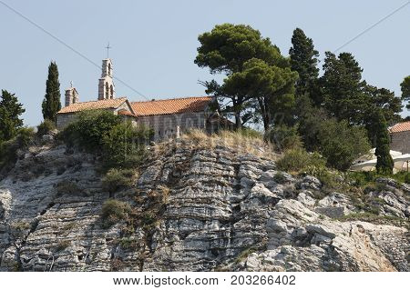 BUDVA, MONTENEGRO - AUGUST 07, 2017:Fragment of the island of St. Stephen on the Adriatic coast in Montenegro
