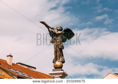 Vilnius, Lithuania - July 5, 2016: Statue Of An Angel Blowing A Trumpet In Main Square Against A Sunny Blue Sky In Uzupis District. Uzupio Republic Or Uzupis Is A Cultural Artistic District, Popular Tourist Place
