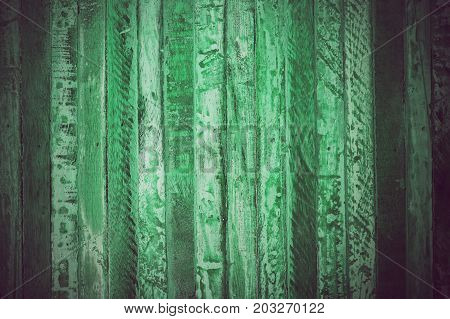 Green vintage wood texture and background. Close up view of green vintage wood texture and background. Abstract background and texture for designers. Rustic table. Texture of handmade green table.