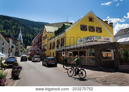 Schladming, Austria - August 15: Tourists Walk On The Street Promenade On August 15, 2017 In Schladm