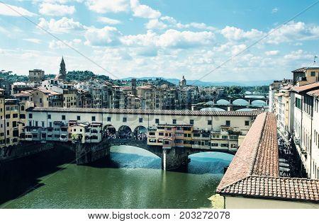 Ponte Vecchio bridge over the river Arno Florence Tuscany Italy. Travel destination. Beauty photo filter.