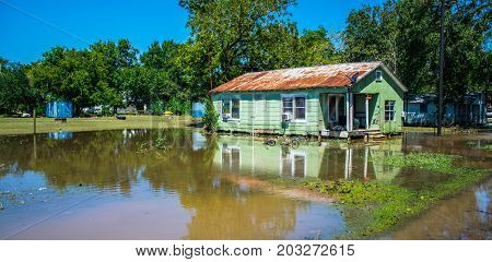 Old Poor Home relfection Flooded after Hurricane Harvey destroyed the town of Columbus , Texas southwest of Houston , Texas a Small Town Disaster easily overlooked