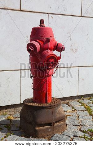 Red fire hydrant in Lisbon Portugal .
