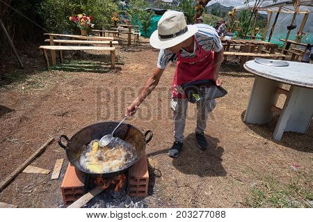 August 5 2017 Medellin Colombia: a man is preparing deep fried empanadas at the flower festival long weekend