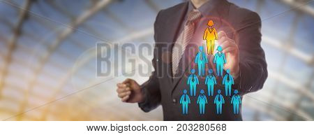 Unrecognizable blue chip recruitment manager selecting the female white collar worker icon atop a corporate pyramid of employees. Business concept for talent acquisition equality and female quota.