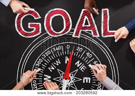 People Drawing Compass Goal Guidance Concept On Blackboard