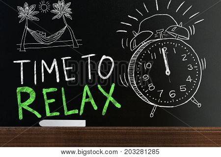 Time To Relax Words On Black Blackboard