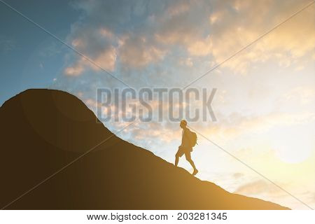 Photo Of Man Hiking On Mountain At Sunset
