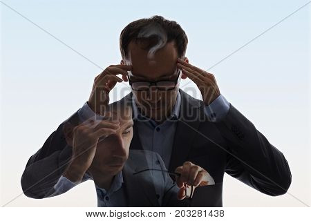 Double Exposure Of Businessman In Suit And Glasses Having Headache