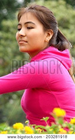 Stretching Minority Teen Female Wearing a Pink Sweatshirt