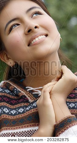 Cute Female Daydreaming Wearing a Knit Sweater