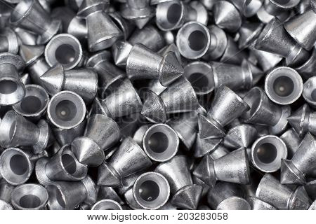 Closeup of air gun pellets with pointed head for training shooting