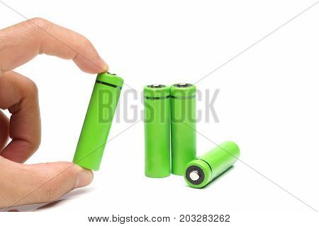 Hand holding a green rechargeable aa battery - using environmentally friendly product concept