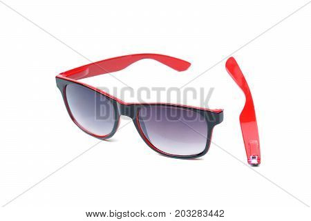 Broken sunglasses with damaged leg isolated on white