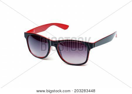 Sunglasses in black and red color isolated