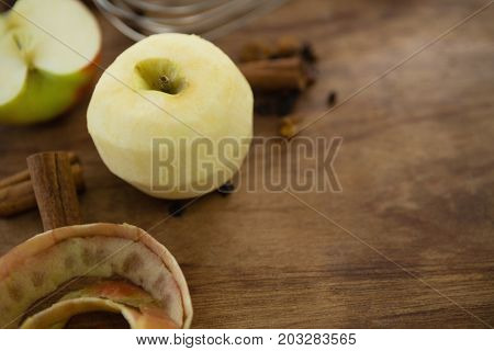 High angle view of granny smith apple with spices on wooden table