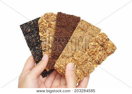 Hands holding multigrain bars / Healthy food and snack concept