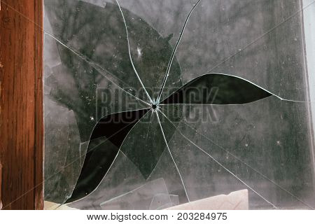 Broken glass with the hole from the bullet
