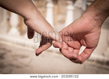 Hands of two lovers intertwined. Love emotions