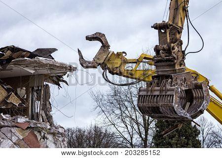 Large demolition cranes dismantling an obsolete building