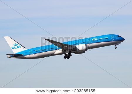 AMSTERDAM-SCHIPHOL - FEB 16 2016: KLM Royal Dutch Airlines Boeing 787 Dreamliner airplane take-off from Schiphol airport.