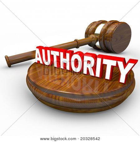 A judge's gavel and the word Authority symbolizing the control exercised by a person in a superior role to make final decisions