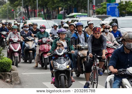 HO CHI MINH CITY (SAIGON), VIETNAM - JULY 2017 : Road traffic in Saigon, Vietnam. In the biggest city in Southern Vietnam are more than 4 mil. motorbikes, the traffic is often congested