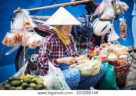 HO CHI MINH CITY (SAIGON), VIETNAM - JULY 2017 : Street vendor in  Ho Chi Minh City, Vietnam