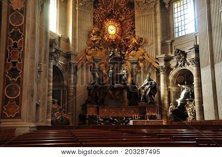 St. Peters Basilica,Vatican Rome Italy,November 6th 2010.The Throne of St.Peter at the Vatican in Rome Italy.The relic is enclosed in a sculptured gilt bronze casing designed by Bernini.Come enter St.Peters ans be absolutely amazed.