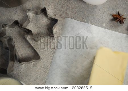Close up of butter with pastry cutters on table