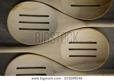 Close up of spatulas arranged side by side on table