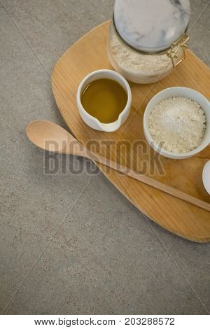 Ingredients on cutting board at table