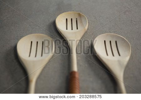 High angle view of spatulas arranged side by side on table