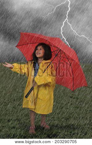 Girl In Raincoat Holding Umbrella