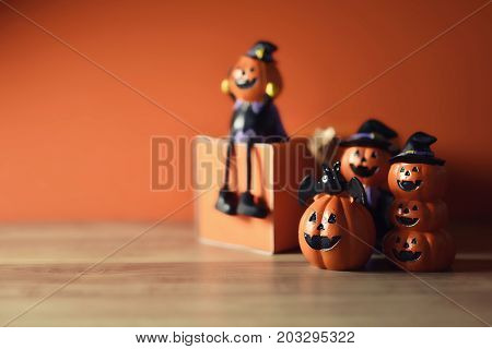 Halloween pumpkins jack-o-lantern on orange and wooden background. Halloween pumpkin background. Halloween. jack-o-lantern. Halloween jack-o-lantern. Happy Halloween.
