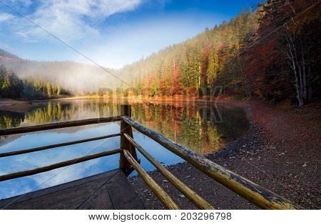 Wooden Pierce Fence On A Lake In Fog