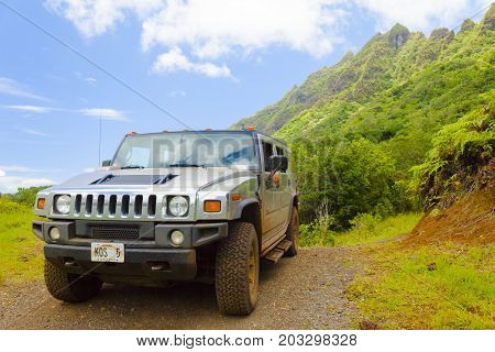 Hawaii - June 2012: A tourist guid drives his hummer to explore the magneficient landscape with them.