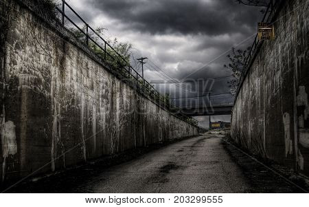 gloomy dark pathway to another road or place.