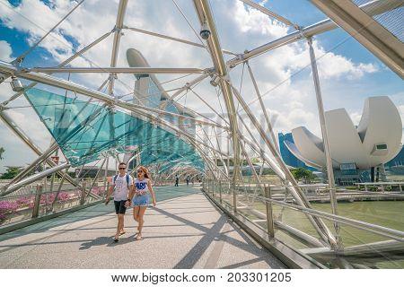 Asian Couple On Helix Bridge In Marina Bay, Singapore